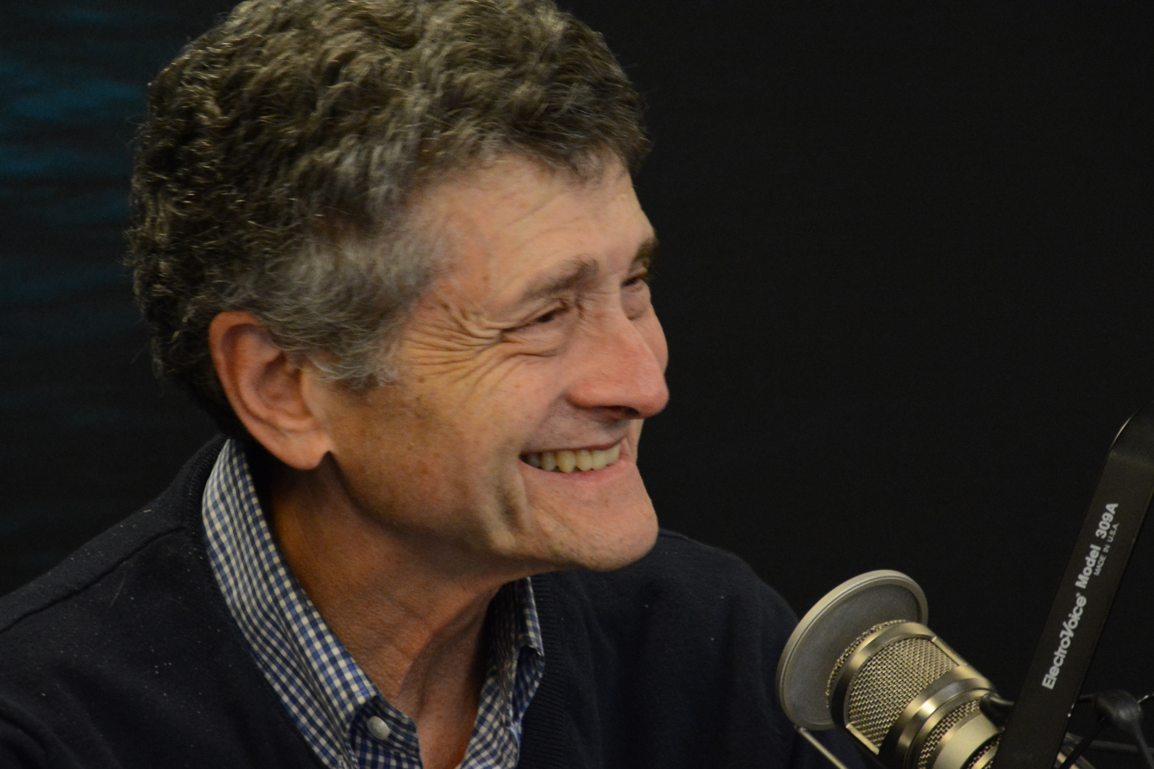 Michael Medved smiling in front of the microphone during a taping of Great Minds